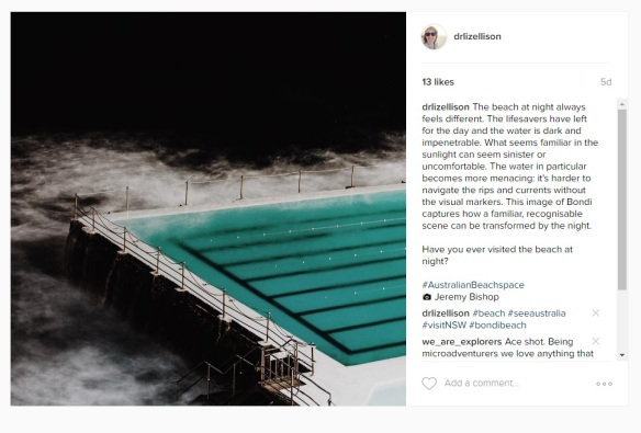 Screen capture of an Instagram post, showing an image of Bondi Beach at night and a caption.